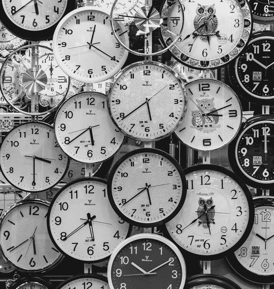 black and white photo of clocks